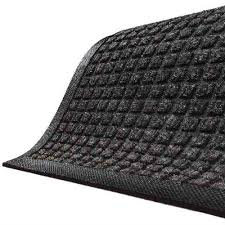 Waterhog Classic Charcoal entrance mat in a corner view detailing a standard rubber water dam edge and a waffle pattern for the surface of the floor mat