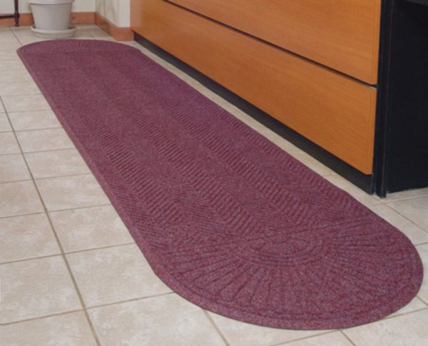 Waterhog Eco Grand Elite floor mat with Oval Two Ends placed in front of a service counter