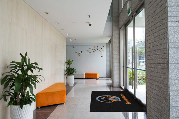 Business Entrance using Classic Impressions HD logo mat as an indoor door mat on top of granite floor