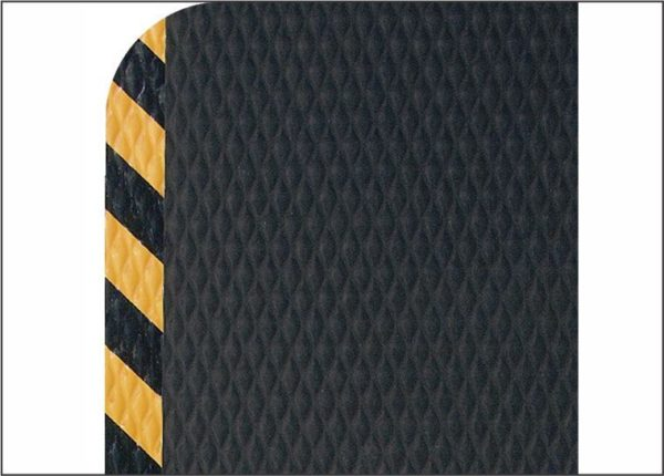 "Close up Coner view of Hog Heaven anti fatigue matting with Yellow Striped border in a 7/8"" floor mat thickness"