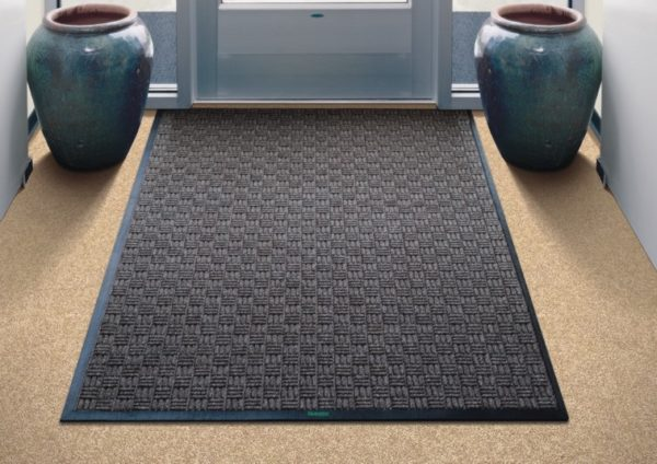 A large indoor mat called Waterhog Masterpiece Select floor used as an inside front door mat to an office building