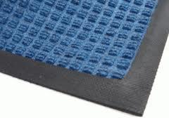 Corner view of Medium Blue Waterhog Classic door mat with standard black rubber water dam edging