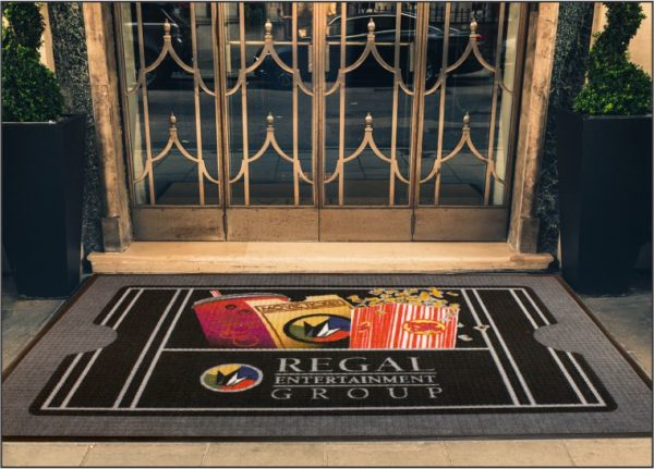 Waterhog Impressions HD custom logo mat with standard rubber edging used as an outside entrance mat to a theater