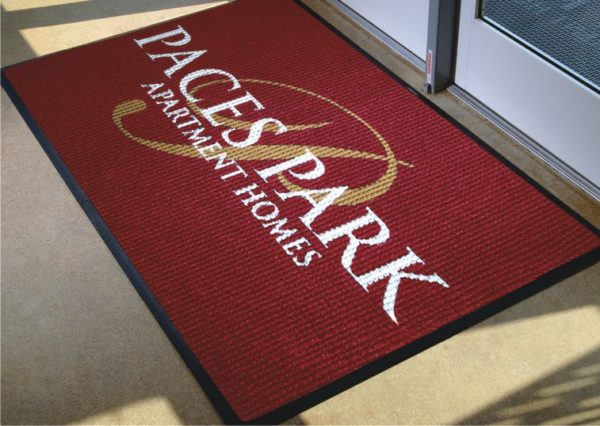 Waterhog Inlay custom floor mat with logo used inside an apartment building as an indoor logo mat