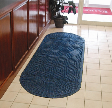 Waterhog Eco Grand Premier Oval Two Ends used as a floor mat runner in front of a hotel check in counter