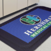 Close up view of a Hog Heaven Impressions Logo mat with logo embossed on a high quality anti fatigue matting in a hospital setting
