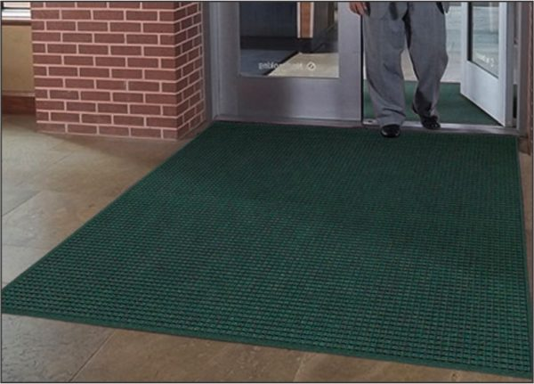 Waterhog Drainable floor mat used as outdoor entrance mat to a school