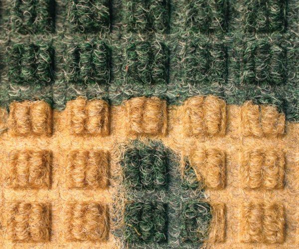Close up view of Waterhog Classic Inlay logo mat process