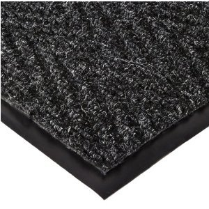 Corner detail of Chevron entrance matting detailing black vinyl edges and herringbone surface pattern