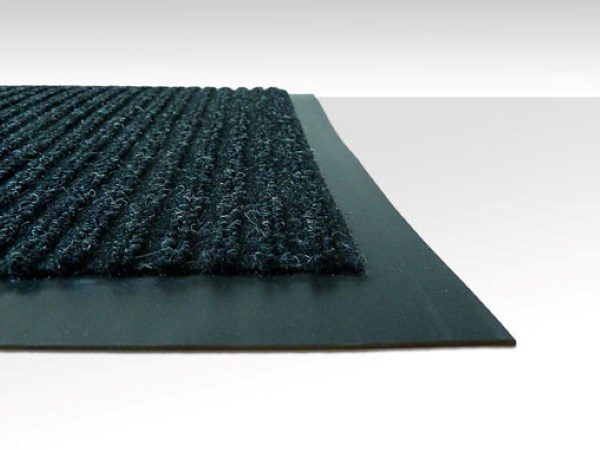 Close up corner view of Dual Rib Walk off matting in a charcoal color showing the smooth vinyl edges and ribbed surface pattern