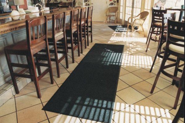 Olefin Indoor floor mat used as a runner on a hard floor in a restaurant