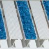 Close up view of aluminum footgrille recessed mat with alternating tread inserts of Serrated and Carpet treads in a mill finish