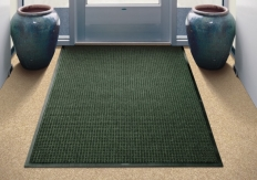 Waterhog Classic Evergreen floor mat used as an indoor door mat to a medical office building