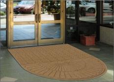 Waterhog Eco Grand Elite Floor Mat - Half Oval used as an outdoor door mat to a business