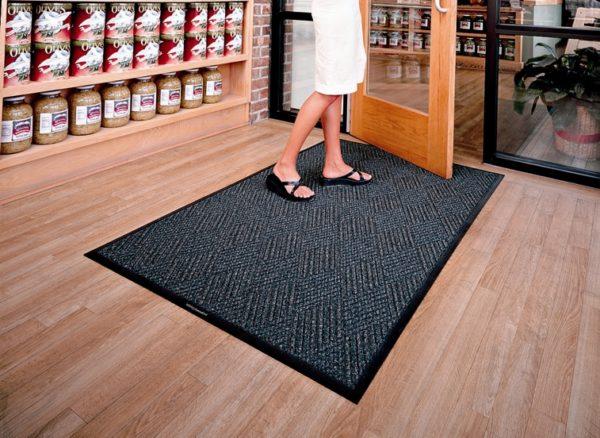 Lady walking on a Waterhog Diamondcord indoor floor mat used in a retail store application