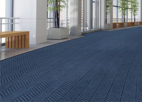 Large door mat application using Waterhog Eco Elite roll goods in the atrium lobby of an office building