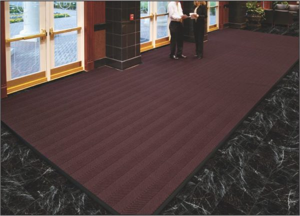 Large floor mat custom cut in hotel lobby entrance using Waterhog Eco Elite Roll Goods entrance matting