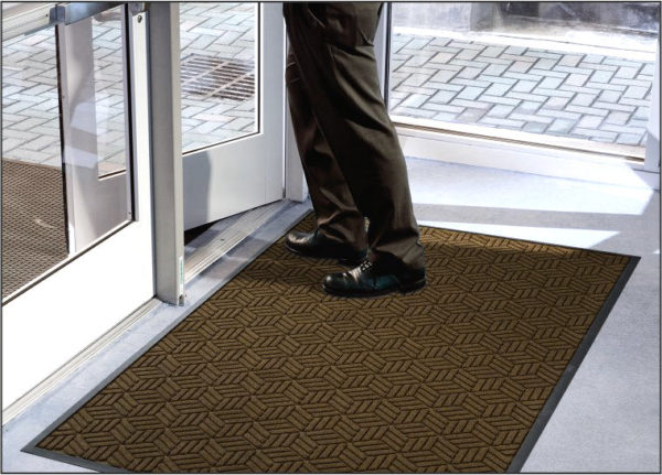 Waterhog Legacy Classic Front Door Mats with Standard Edge used as a Zone 2 indoor floor mat to an office