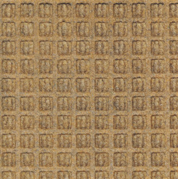 Close up view of Gold Waterhog Classic entrance mat showing waffle surface pattern of the carpet mat