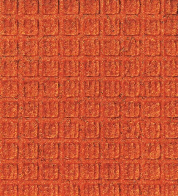 Close up view of Orange Waterhog Classic entrance mat showing waffle surface pattern of the entry mat