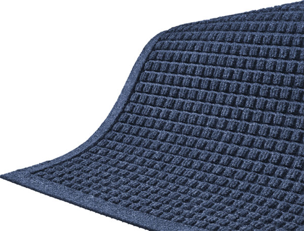 Close up corner view of Waterhog Classic entry mat with fashion border with floor mat color of Medium Blue