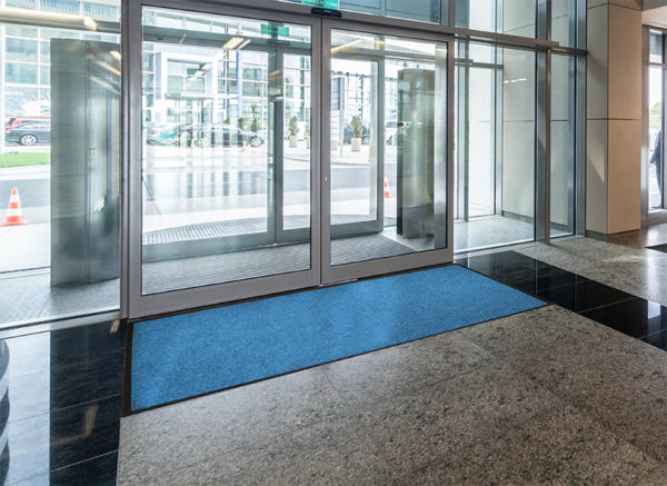 Waterhog Classic Diamond walk off mat used as an indoor door mat to an office building as a Zone 3 floor mat