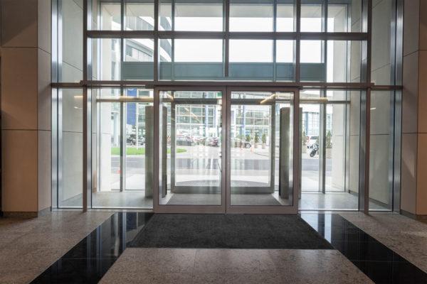 Inside entrance of office building using Tri Grip Indoor Floor Mat as a Zone Three Wiper floor mat