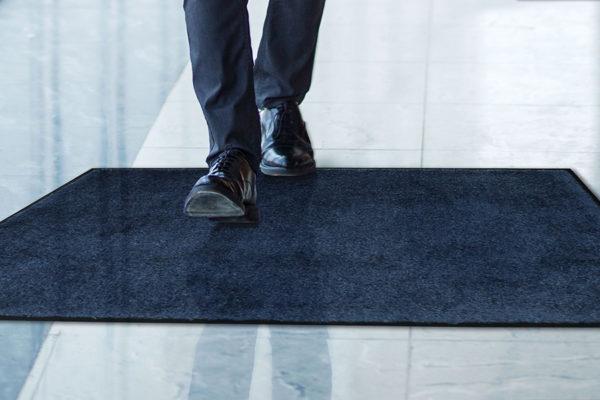 Man Stepping on Tri Grip Indoor floor mat