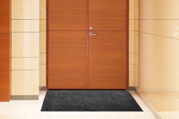 Tri-Grip Indoor Floor mat in front of double doors