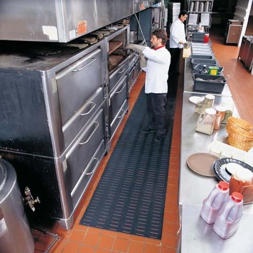 Versa Runner Industrial Kitchen Mat used as an anti fatigue kitchen mat in a restaurant