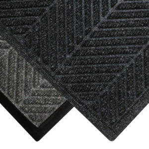 Corner view of Waterhog Eco Elite floor mat with two floor mat edge options - Standard rubber and Fashion border edging