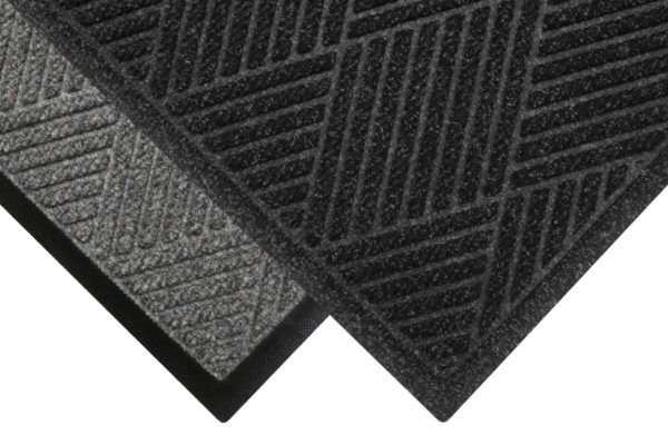 Corner View of Waterhog Eco Premier floor matting with two floor mat edge options - Standard Rubber and Fashion Border