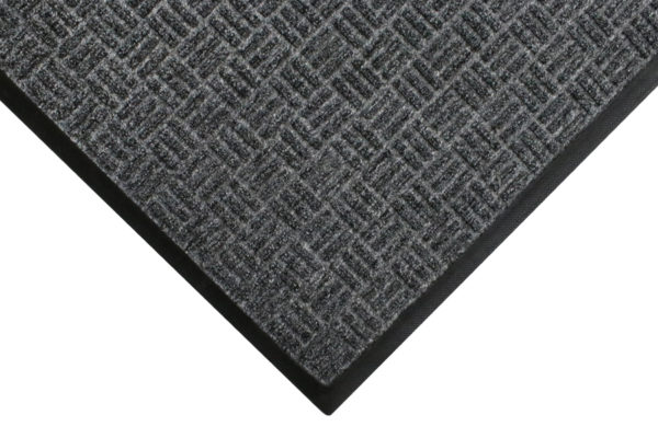 Corner view of a Masterpiece Select Entrance Mat Pewter with Standard Rubber Edges