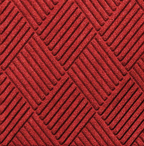 Close up view of Waterhog Classic Diamond floor mats in the color Solid Red