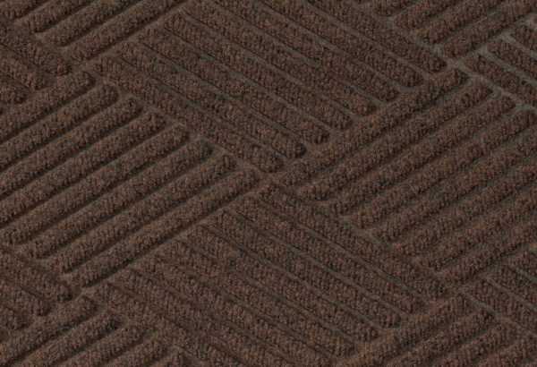 Close up surface view of Waterhog Eco Premier carpet mat in a Chestnut Brown color