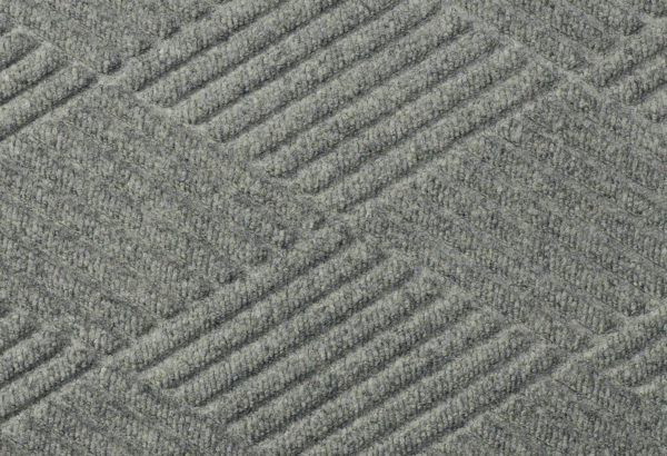 Close up surface view of Waterhog Eco Premier floor matting in a Gray Ash color