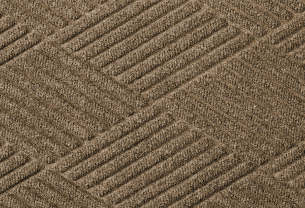 Close up surface view of Waterhog Eco Premier floor matting in a Khaki color