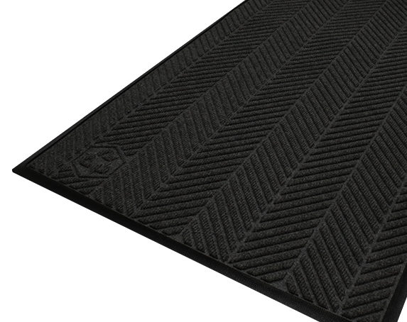 Corner view detailing surface pattern of a Waterhog Eco Elite entrance mat with standard edges in a Black smoke