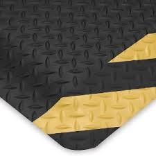 Corner Detail and surface texture for Diamondplate anti fatigue matting - Black with Yellow Chevron border