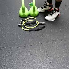 "Person standing on Rubber 1/2"" Interlocking Gym Flooring showing puzzle interlocks"