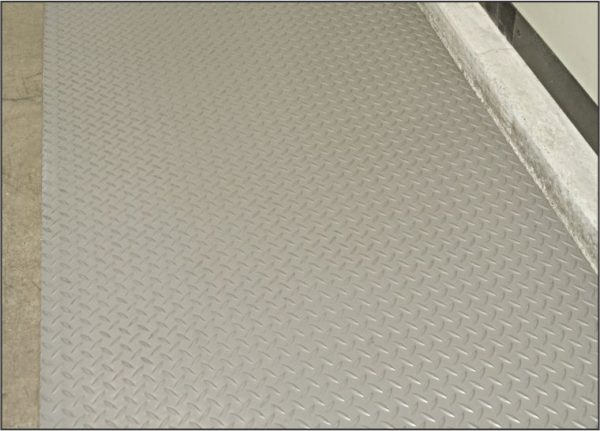 Close up view of gray Military Diamondplate Switchboard safety matting used as a runner