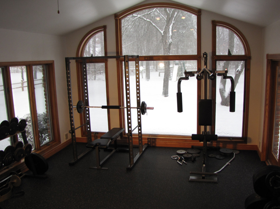 Home Gym with rubber flooring to protect home flooring