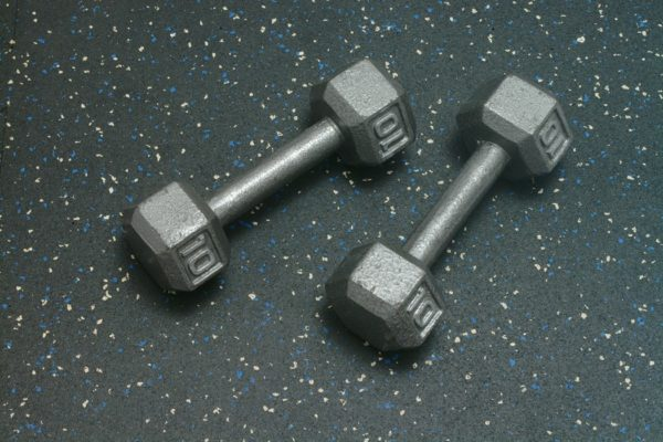 Dumbells resting on Rubber Gym Flooring for home gyms - Blue Gray Color Fleck