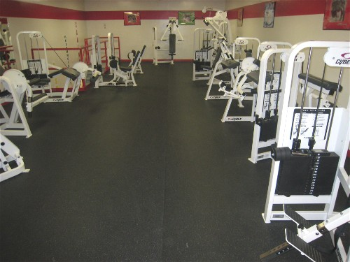 Heavy Duty Rubber Gym Floor matting with gym equipment placed on it in a high school gym