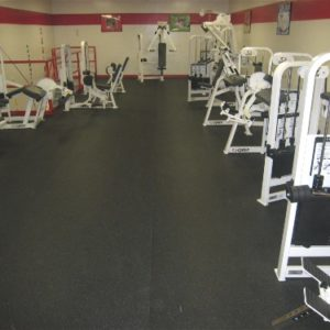 Rubber Rolled Gym Floor with gym equipment placed on it in a commercial gym