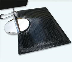 Sports Beauty Salon Mat with cut out with stylist chair sitting on top of the Black Diamond pattern floor mat surface