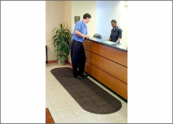 Waterhog Grand Classic Floor mat with Oval Fans on Two Ends in front of Hotel Check in counter