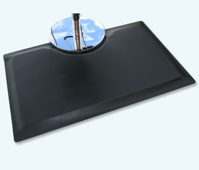 Multi Flex Salon Mat with cut out with stylist chair sitting on top of the smooth black floor mat surface
