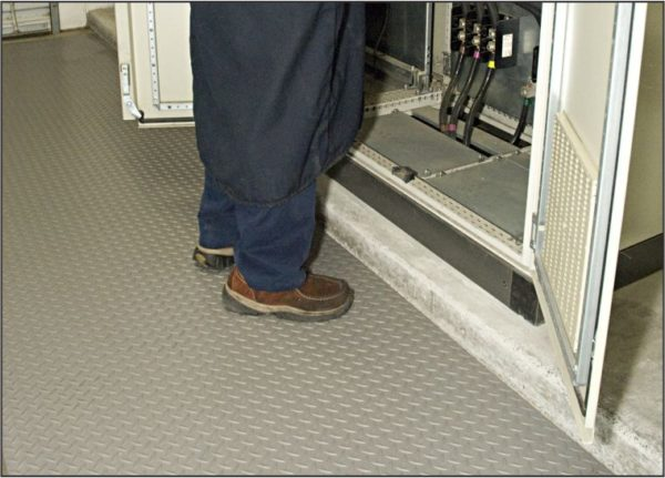 Man Standing on Gray Military Switchboard nonconductive floor matting to prevent electric shock