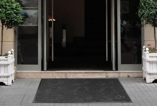Waterhog Plus Swirl Entrance Mat Floor Mat used as an outdoor mat for an apartment building